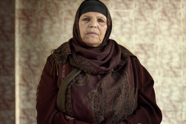 """Tunisia- 12-12-2011-Manubia, Mohamed Buazizi's mother. She left the village and is now living in a house that was given to her by the new government in the new neighbourhood of La Marsa near the city of Tunisia. This woman has seen how her son was turned into a symbol of revolution in all the Arab world. """"I hope the death of my son can change something"""". She left her house in the village and is now trying to start a new life in La Marsa."""