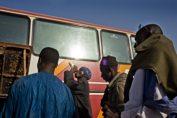 Travellers in a bus stop of the route Bamako-Mopti.