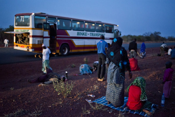 Bus stop on the Bamako-Mopti route. A group of passengers pray at sunset. The next to last prayer of the day.