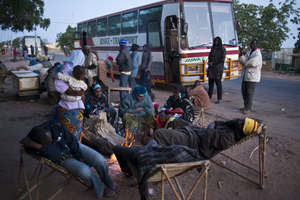 Passengers after spending the night in a village a few kilometres from Segou. Waiting for the mechanic to repair the bus.