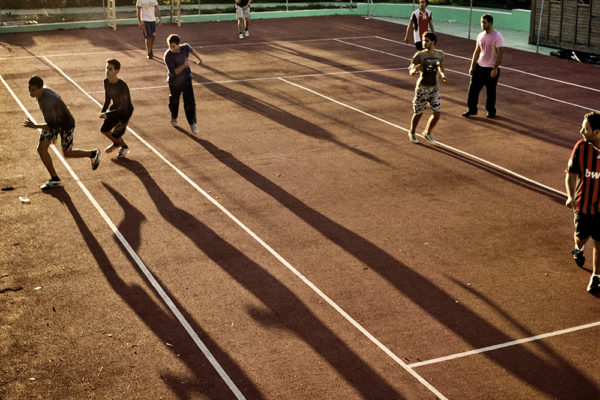 Tunisia- 12-12-2011-Young people playing football in one of the football grounds of Sidi Bousaid. The surroundings of the palace, that were part of the facilities of the palace itself, like football fields, tennis courts and vast green areas or parks have been opened to the public after the revolution. All Tunisians can now walk or do sport in an area that before was restricted to them.