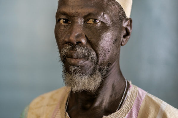 """Victims Of Hissene Habré crimes.  Jean Noyoma Kovounsouna,  He was the subject of a false accusation, he was tortured with water .""""He was tied his feet with the arms and made hium drink water.. Sleeping six people in a cell  of two square meters."""