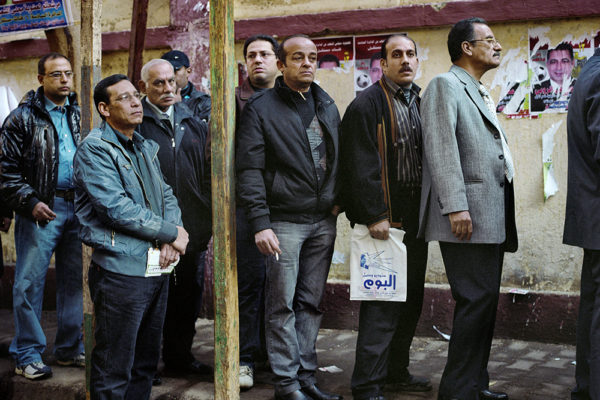 Egypt 23-11-2011Group of men waiting in line to vote at a polling center in Cairo. The first elections after the fall of Mubarak had a high participation. They voted three rounds and with a share around 60 percent. The absolute winners were the Muslim Brotherhood with about 50 percent of the votes.