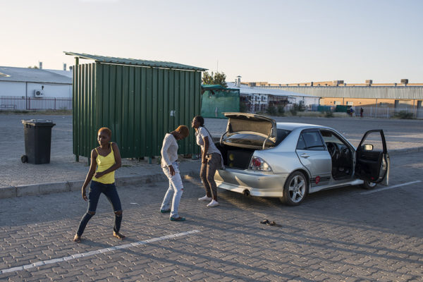 Group of girls dancing with the music of her car in Ghanzi bus station.