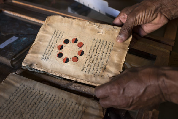Manuscript on astronomy Habot collection in Chinguetti. The open page shows and explains the various phases of the moon. This is the most important city library, a true crossroads for traders who crossed the Sahara and must stay for pilgrims traveling from Mauritania to Mecca step.