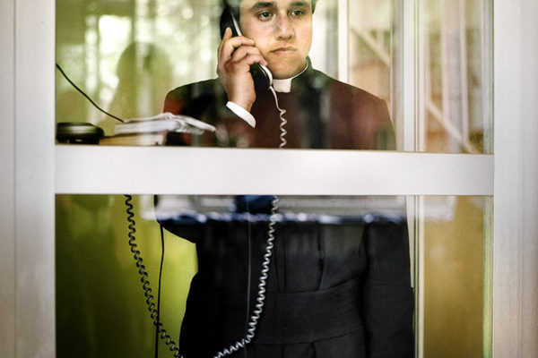 """A seminarian in the telephone  of the seminar in Salamanca. Legionnaires' contact with their families is limited to once a month. Direct contact is always at the mercy of the superior's decision. """"don´t look back"""", always repeated in the congregation."""