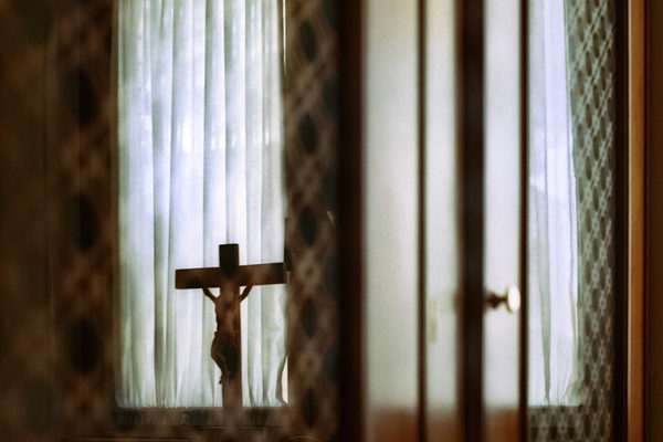 Rome.reflection of a cross on a confessional