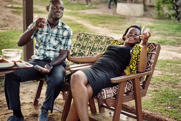 Young couple drinking wine in a private beach in Accra city.