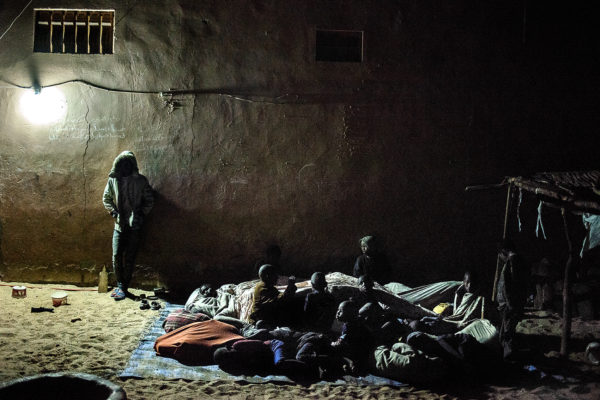 Night time in Cheikh Amadou Bamba's daara. it's in Pikine neighbourhood in Saint Louis. Children crowd up together to sleep under a piece of fabric. It's January and it's cold in Saint Louis.There are about 50 talibes, most of them come from the village of Dhara Yolof in the region of Louga.