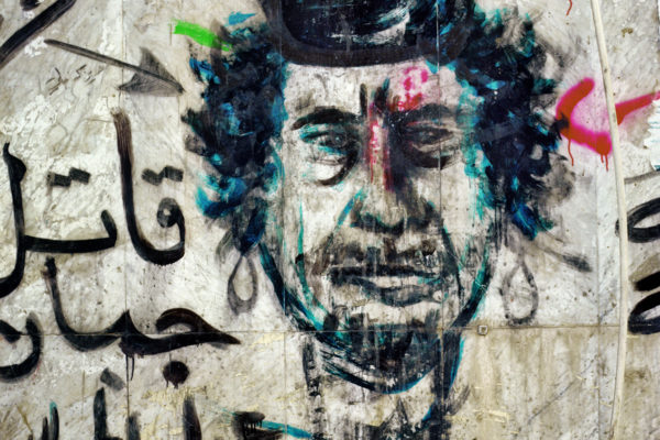 Lybia. 01-12-2011painting of Gadaffi's face in the city of Bengasi. Hundreds of new paintings and graffiti decorate the city of Benghazi since the rebels took control of the city. Most of them are grotesque caricatures of the dictator who embodied the representation of the Lybian state.