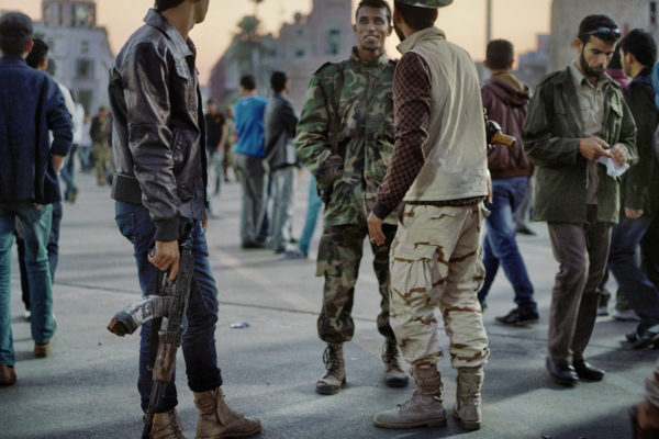 Lybia. 01-12-2011. TripoliRenamed as Martyrs' Square, it was before known as Green Square. It is normal to see armed militiamen walking through the square. The disarmament of the militias is a complicated issue and proof that the situation in Lybia has still not gone back to normal.
